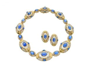 Bulgari and Rome - Gold necklace, sapphires, rock crystals and diamonds. Gold earrings, sapphires, rock crystal and diamonds (1980, approx.). Ellissi sign, Oval inspiration of Piazza del Vaticano
